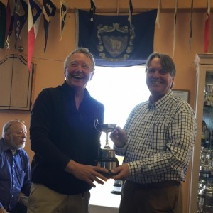 Winning Skipper Robert Floate receiving one of his trophies from sponsor Mark Corrin